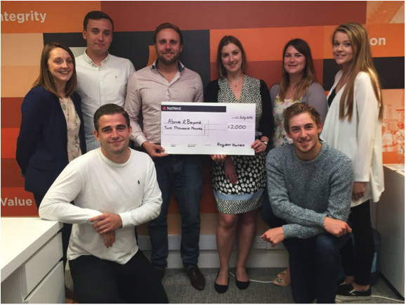 The Kingston Barnes team proudly presenting our cheque to Above & Beyond