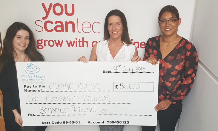 Scantec FMCG team hand over £5000 Claire House cheque