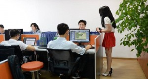 A Chinese technology company has turned to 'cheerleaders' to motivate male employees